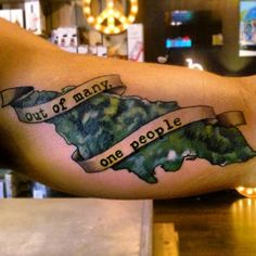 """Jamaican tattoo with the island's motto, """"out of many, one people""""."""