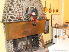 Ancient rocks fireplace and wood stove from the '50s