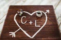Wedding rings amid love heart sign