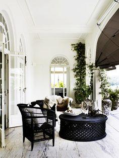 pretty patio // bamileke tables, rattan chair