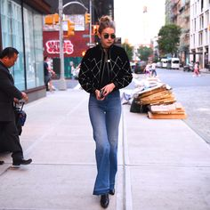 Gigi Hadid was looked edgy in a fashion-forwarded studded black bomber jacket and bootcut jeans.  (Photo by Robert Kamau/GC Images)  via @AOL_Lifestyle Read more: http://www.aol.com/article/2016/06/23/sexy-stars-abbey-lee-olivia-culpo-take-the-plunge/21400982/?a_dgi=aolshare_pinterest#fullscreen