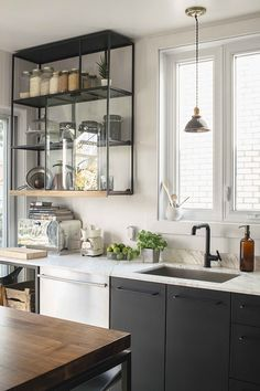 kitchen-with-black-faucet-and-black-open-shelving