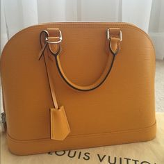 Like new! Louis Vuitton Alma PM EPI Leather Used once!  Comes with receipt, dust bag, and cards.  Clean inside. No wear on leather. Comes with lock and key. Silver hardware. I am selling so I can pay for my wedding otherwise I would keep this lovely bag. This bag looks brand new. Louis Vuitton Bags Totes