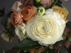 Bridal bouquet featuring an EXTRA large French ranunculus, peachy roses and traditional ranunculus, anemonies and jasmine.
