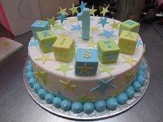 Wicked Chocolate cake iced in white butter icing decorated with fondant building blocks, 3D soft blue #1, fondant stars & wired stars   Flickr - Photo Sharing!