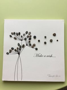Modern contemporary style original dandelion pebble art . pebbles are in shades of grey to get the perfect look,framed by me in 10 x10 white shadow box.comes as shown in picture.