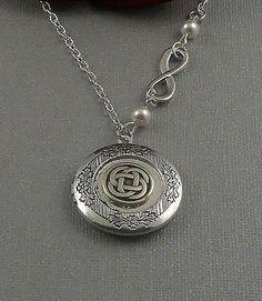 LOVE IT! Silver Celtic Knot Locket Antique Silver by ManoCelebrates on Etsy, $23.00