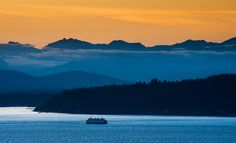 Ferry Boat and the Olympic Mountains - A ferry boat from Bremerton, Washington…