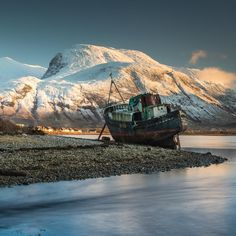 Corpach Boat Wreck and a snow covered Ben Nevis, Scotland