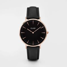 The Cluse La Boh̬eme model features an ultrathin case with a 38mm diameter, crafted with precision for a sophisticated and elegant result. Black and rose gold are combined with a black leather strap,
