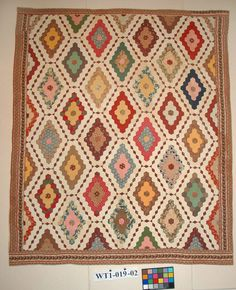 Hexagonal mosaic patchwork quilt made by an unknown quilter, c. 1850.