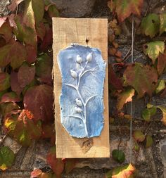 Rustic clay wall hanging, art, plaque, imprint of rose hips and leaves mounted on reclaimed wood. Blue and white. by Margesgallery on Etsy