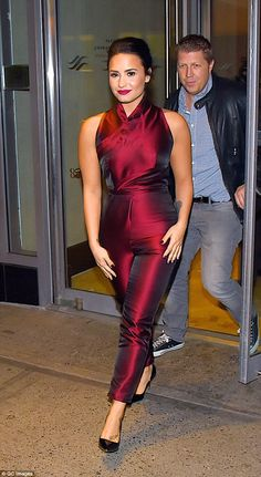 Fab figure: The 23-year-old singer made the most of her amazing physique in her skin-tight one-piece with its crossover neckline