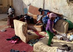 Saudi children play on old furniture outside of the home in which they live in a poor neighborhood in South Riyadh.