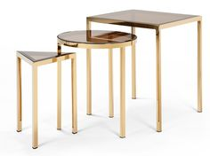 Nova Nesting Side Tables, Brass A square, a circle, and a triangle. It's that easy. Modern and minimal, Nova's design is sophisticated and simple. The glass creates gorgeous hues of gold when the pieces are stacked together. £229   MADE.COM - love that they are different shapes.