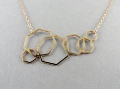 geometric jewelry, geometric necklace, heptagon necklace * oohhh shapes shapes and more shapes! For the geometry lovers out there, here are six Septagons\Heptagons that make up this pretty geometric necklace  Heptagons pendant measures approx 5 cm across its made of brass plated in 24K gold the chain and findings are goldfilled , chain is 36 cm long with extra 7 cm extension for length adjustments  thanks so much for looking! ______________-------_______________    If you require a custom…