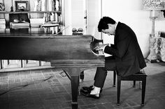 """""""During one shoot at a house, he was waiting for us to set up a backdrop, and he sat down at the piano and started playing and singing.  I immediately told the assistants to pull down the backdrop, which was blocking the light coming though the windows to where the piano was— afraid I would miss this moment.  No problem—Downey played a 45 minute concert that gave me plenty of time to make a series of great pictures, and he enthralled everyone in the room with his performance."""" — Sam Jones"""