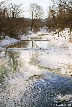 Landscape with a river melted from the ice in northern Ukraine - on Fotolia