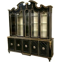 Hollywood Regency Style Ebonized Breakfront Grosfeld House | From a unique collection of antique and modern bookcases at http://www.1stdibs.com/furniture/storage-case-pieces/bookcases/