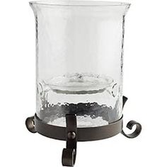 Hammered Glass Hurricane    $60  Think of it as a pedestal for your favorite pillars. This candleholder is crafted of mouth-blown glass on an iron stand for a classic look that works virtually anywhere. A Pier 1 exclusive.