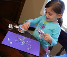 tin foil snowflake craft-maybe a tinfoil mosaic could be made with little bits of colored chocolate wrappers