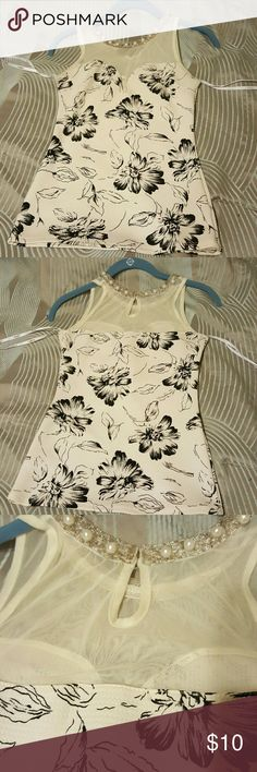 Blouse Black and white flower blouse with bead and lace work near neck line. Clips in  the back. Off white. Form fitting. Size small. Sleeveless. Papaya Tops Blouses