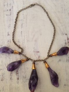 Amethyst stone wire wrapped with gold cap and brass chain.