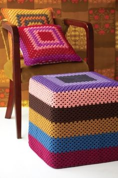 """There are many motifs that fall under the description of """"Granny Square,"""" but none are so classic, recognizable, or versatile as the original. The Granny Square motif is often one of the first crochet items a crocheter learns after mastering the. Crochet Pouf, Crochet Cushions, Crochet Granny, Crochet Gifts, Love Crochet, Ottoman Slipcover, Slipcovers, Ottoman Cover, Crochet Furniture"""