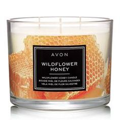 Fill your home with the sweet aroma that is AVON's Wildflower Honey Candle. Enjoy notes of honey apple bourbon and cinnamon with this mood enhancing candle. Shop one now. Fall Candles, 3 Wick Candles, Scented Candles, Candle Jars, Candle Holders, Candle Shop, Apple Bourbon, Honey Love, Avon Catalog