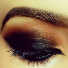 Dark... Looks like a Katniss Everdeen costume makeup