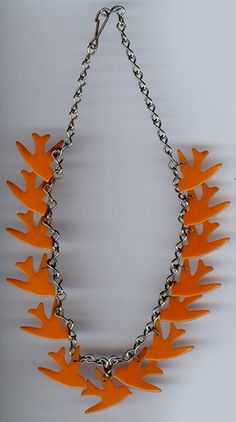 VINTAGE ORANGE BAKELITE FLYING BIRDS DANGLE NECKLACE