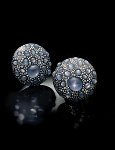 A pair of sapphire and diamond 'shield' ear clips, by JAR