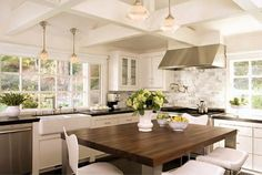 White kitchen with wood top island