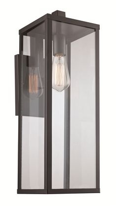 4075 Outdoor Wall Light features Clear glass with a Black finish. Available in small, medium, and large sizes. One 60 watt, 120 volt Edison A-Shape Medium base incandescent bulb is required, but not included. Wet location rated. Small: 5 inch width x 12.5 inch height x 8 inch depth. Medium: 6 inch width x 17.75 inch height x 9 inch depth. Large: 7 inch width x 22.5 inch height x 10 inch depth.