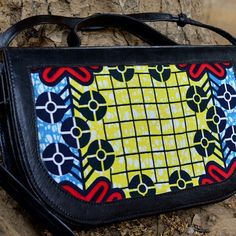 Hand dyed black leather bag with a beautiful African Wax print material. Can be worn as a clutch or cross-body handbag. Handmade in Senegal.  #senegal #handmade #handcrafted #handbag #clutch #crossbody #africanfashion #westafrica #shopsmall #africa #ladyboss #ethicalfashion #africanprint
