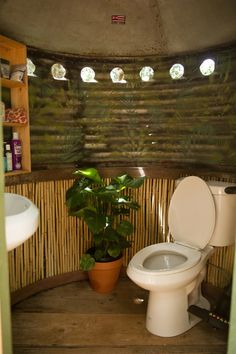 tropical bathroom by Ashley Camper Photography This would be a great version for a separate bath house with a composting toilet and maybe a solar shower. Tropical Bedroom Decor, Tropical Bedrooms, Tropical Bathroom, Bohemian Bathroom, Diy Bathroom Decor, Bathroom Colors, Downstairs Bathroom, Bohemian Bedrooms, Indoor Outdoor Bathroom