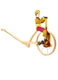 Ciclista by Ernisinde, Portugal: Very nice wooden push toy for a toddler complete with a bell on the wheel.