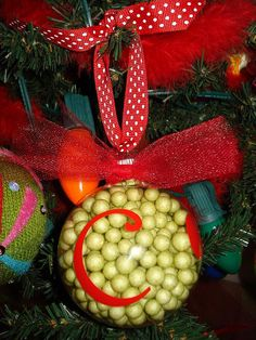I could so make these...little greens balls at Hobby Lobby and scrapbook rub on letters with a cute ribbon...thought gifts for VT sisters?