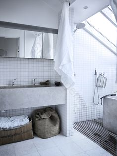Love the skylight above the bath. I've done something similar, a roof light right above the shower... looking at a starry night while taking a shower, not bad uh?!