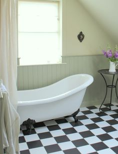 Slipper claw foot bath in French Grey bathroom