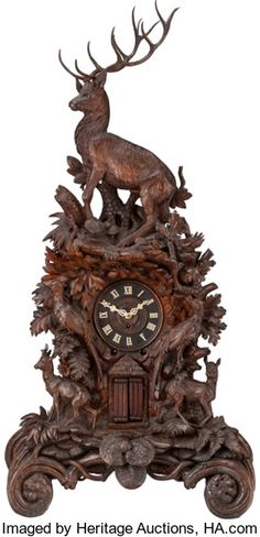 Timepieces:Clocks, A LARGE BLACK FOREST CARVED WOOD AND IVORY MANTLE CLOCK, 19thcentury. 57-3/4 x 27 x 15 inches (146.7 x 68.6 x 38.1 cm). ...