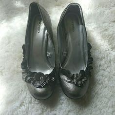 ONE DAY SALE Silver Heels with frill Silver Heels with frill.  Worn twice and in great condition.  Slight scuff on right shoe (see picture).  About 2 in heel.  Offers accepted! none Shoes Heels