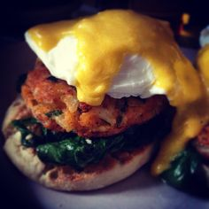 """Catfish Cake on a Bed of Wilted Spinach and English Muffin with Poached Egg Smothered in Bourbon Hollandaise. #bourbon #breakfast #cookingwithbooze…"""