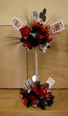 casino centerpieces -Casino themed rehearsal dinner! could also work if your doing an alice theme