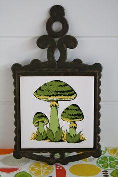 1970's Green Toadstool Trivet with Ceramic Tile, 1970's Kitchen Decor, Vintage Kitchen Decor, Mushroom Decor, Toadstool Decor. $8.00, via Etsy.