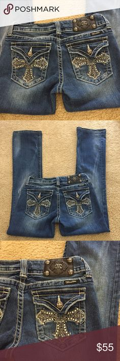 """🥀Miss Me iron cross stretchy bootcut jeans sz 28 🥀Miss Me iron cross stretchy bootcut jeans sz 28. These are stunning flap pocket MM with stud and rhinestone and thick silver stitch  iron gothic crosses. Absolutely stunning! I love these jeans! Some factory distressing. Preloved in excellent condition. All rhinestones rivets and studs intact. Waist lying flat is 14"""". Rise is 7.5"""". Inseam is 32"""". Professional hem. Some wear on hems. See last pic. Boot is 8.5"""". Miss Me Jeans Boot Cut"""
