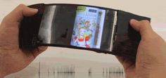 The ReFlex, a prototype flexible smartphone from Queens University, allows you to flip through pages of an ebook by bending the screen. Disruptive Technology, Business Technology, Interactive Mirror, Lg Oled, Best Smartphone, New Gadgets, Cool Tech, Android 4, Electronics Gadgets