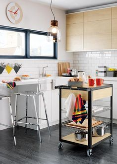 small kitchen with movable work trolley as 'island'