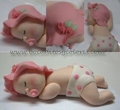 Fondant topper we are giving away for a baby shower (along with a mini cake and 24 cupcakes). Last week we gave away one for a baby boy ;)