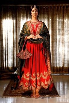 Indian Suits - Anarkalis - Red and Green Suits | WedMeGood Beautiful Blood Red Anarkali with Gold Zari Work on the Bottom and Zari Neck work, With Green Silk Dupatta with Gold work and Gold border. #wedmegood #anarkali #red #green